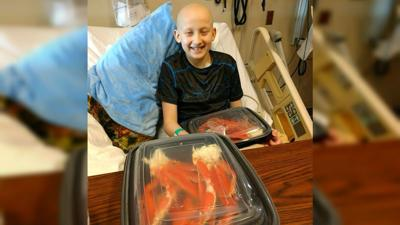 Spokane boy fighting cancer get dream crab dinner