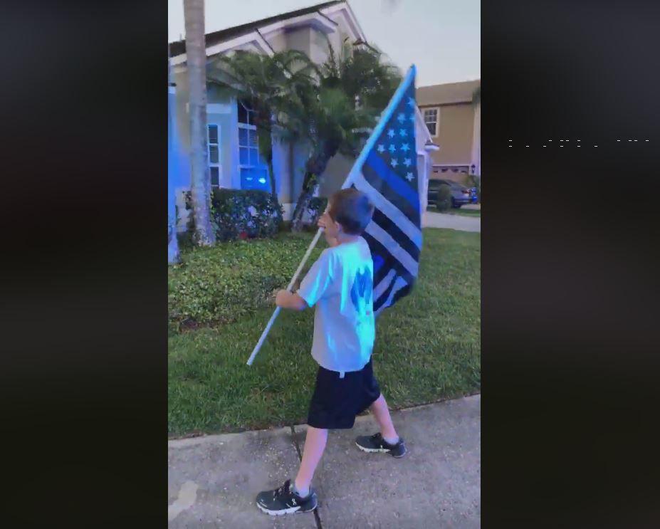 Boy runs with Blue Line Flag to honor fallen Cowlitz County Sheriff's Deputy