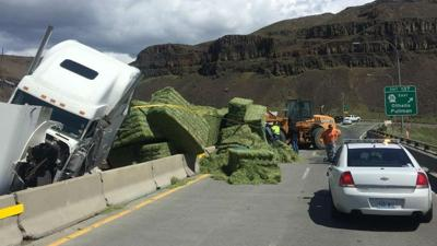 PHOTOS: Semi-truck rollover shuts down Vantage Bridge