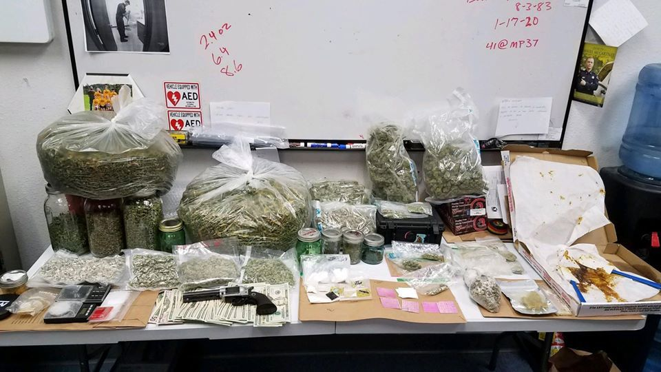 Man arrested with more than 10 lbs of drugs, stolen firearm after mulit-county chase