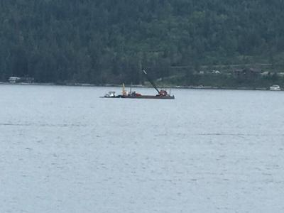 Salvage barge pulling up wreckage of planes five days after mid-air crash over Lake Coeur d'Alene