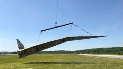 Artist eying record for world's largest paper airplane