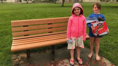 Father, daughters clean bench found with graffiti at Spokane park