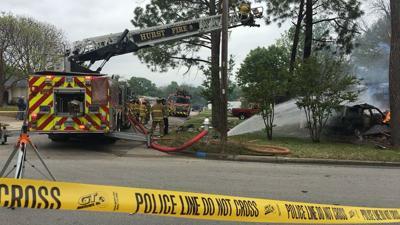 SUV slams into suburban Dallas home, explodes; 5 hurt