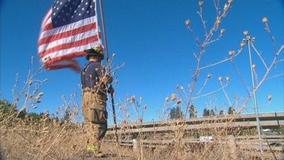 Local firefighter waves American flag every year to remember 9/11