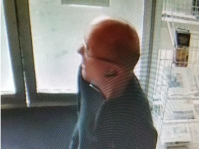 Police looking to identify man after bottle of liquor was stolen from Pullman Sunset Mart