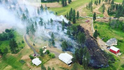 Firefighters contain small brush fire north of Fairchild AFB