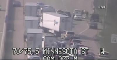 Money scattered across Indiana highway after armored truck's door flings open