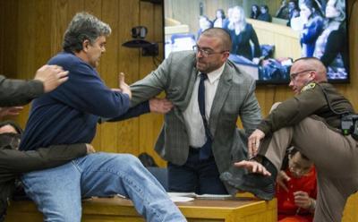 Judge won't punish dad who charged at Nassar