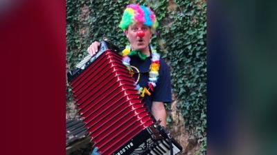 Virginia man organizing clowns to play accordions in front of Sandpoint man's home