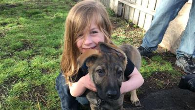 PHOTOS: Spokane family reunited with puppy it says was stolen from yard