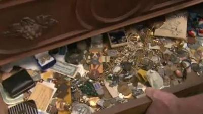 Man finds hidden treasure in estate sale dresser