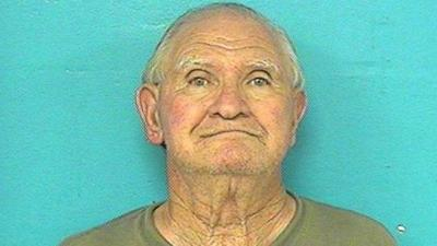 Man run over by lawn mower while trying to kill son with chainsaw