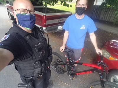 Spokane Police officer returns stolen bike to owner
