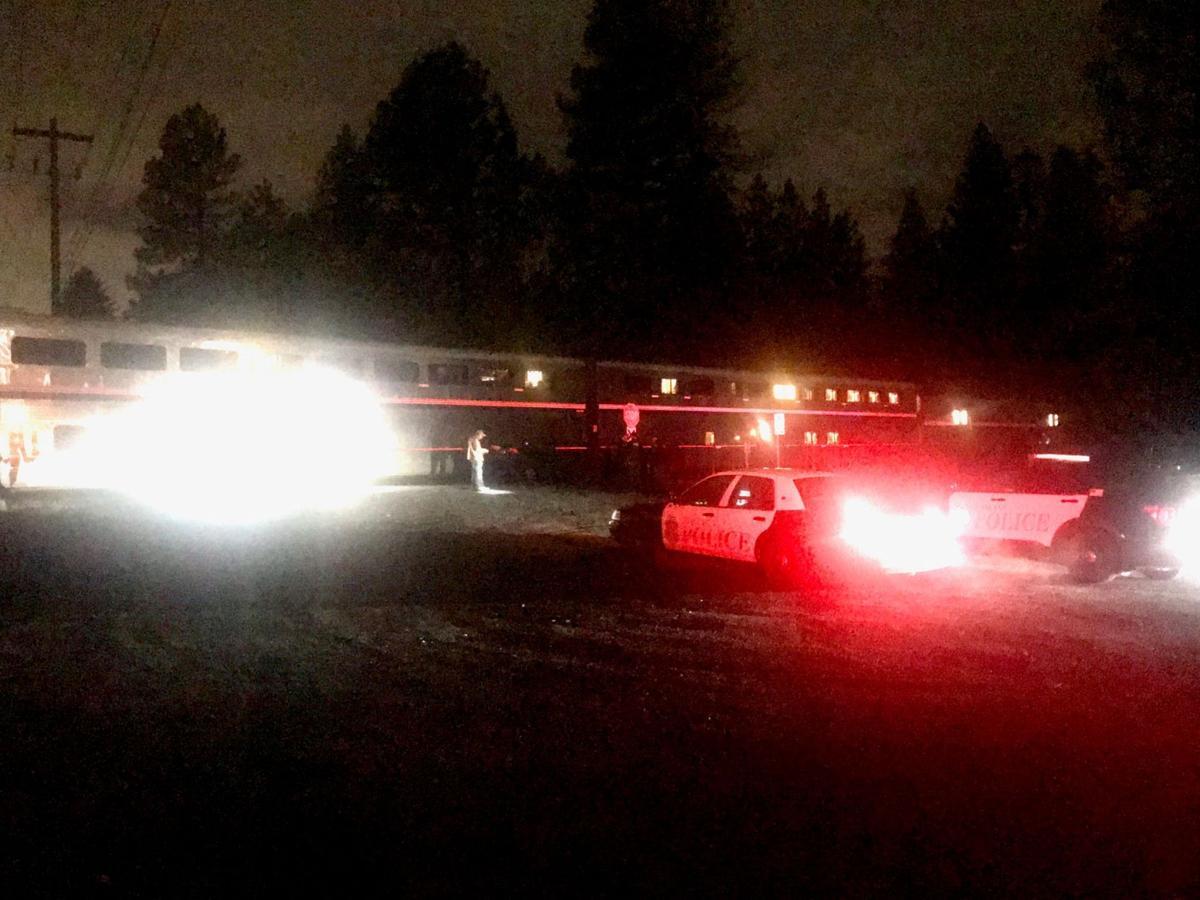 Train crashes into car stuck near tracks in Spokane