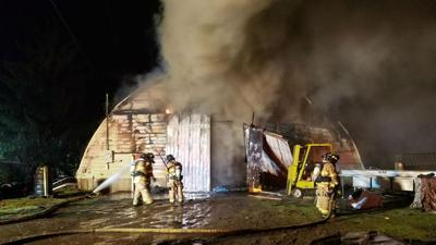 Fire crews work to extinguish large shop fire near Prairie and Huetter in Coeur d'Alene
