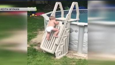 WATCH: Child scales 'un-climbable' pool ladder