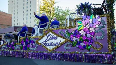80th annual Spokane Lilac Festival Armed Forces Torchlight Parade draws crowd