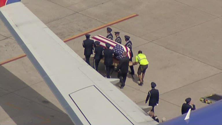 Terminal silent as Vietnam Veteran's remains flown home by his son