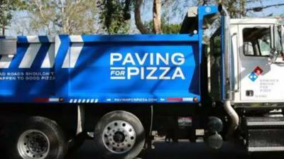 Domino's is paving potholes to protect pizza pies