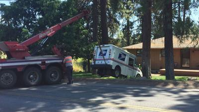 Runaway mail truck crashes into tree in Spokane Valley