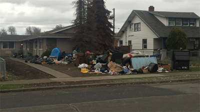 Problem house littered with trash and needles near Stevens Elementary