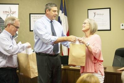 Board honors teachers, outgoing trustees