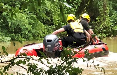 Rescuers pull four from floodwaters