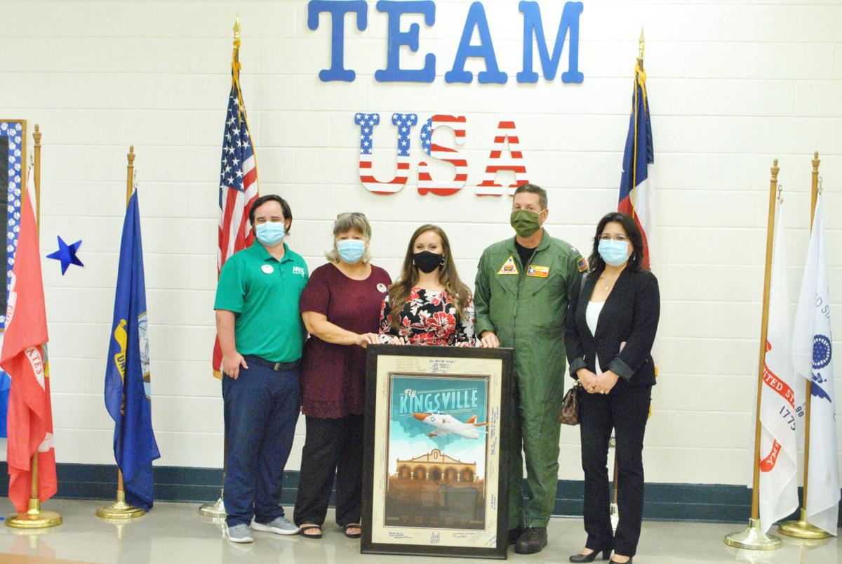 NAS-K presents signage to Perez Elementary