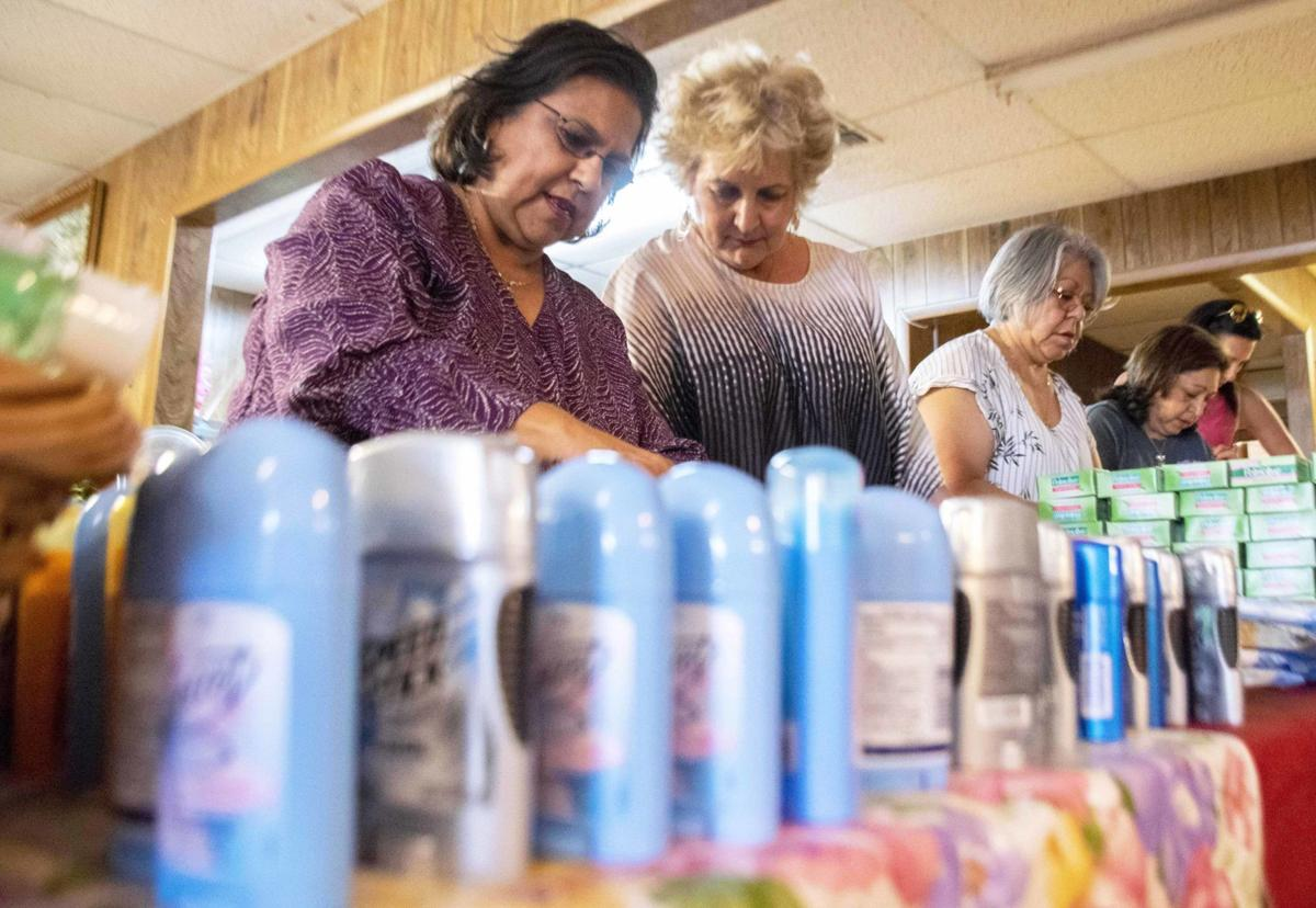 Volunteers gather supplies for immigrants