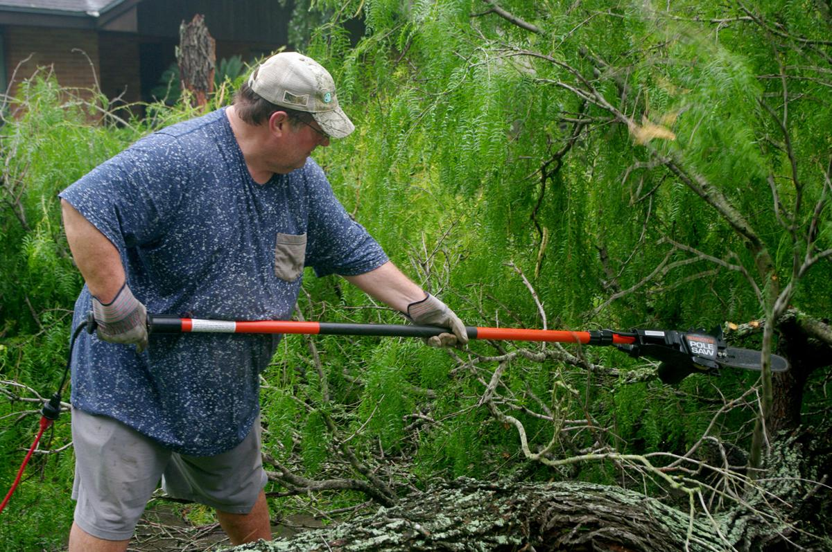 Residents clean up after storm