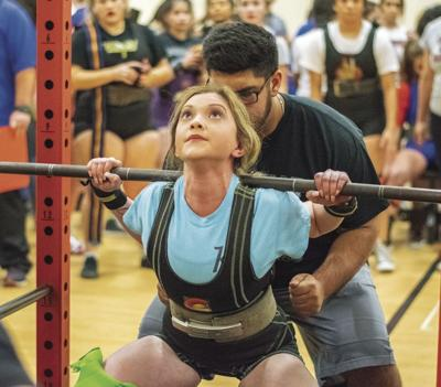 Madelyn Rendon lifting