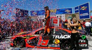 Martin Truex Jr. holds off Kyle Busch to claim fourth win of the season