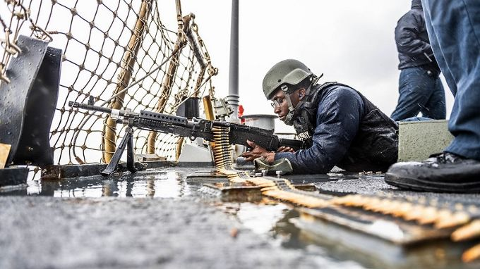 SEA OF JAPAN (Jan. 4, 2020) Gunner's Mate Seaman Apprentice Derion Salter, from Jasper, Texas, prepares to fire an M240 machine gun during a live-fire gunnery exercise aboard the Arleigh Burke-class guided-missile destroyer USS Milius (DDG 69). Milius is