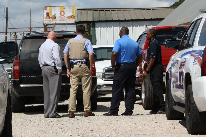 State and local law enforcement execute search warrant at