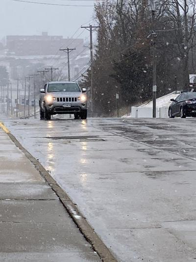 Crews working on keeping Jefferson City roads clear as snow falls, wind gusts
