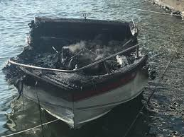 No injuries, but dock damaged by boat fire