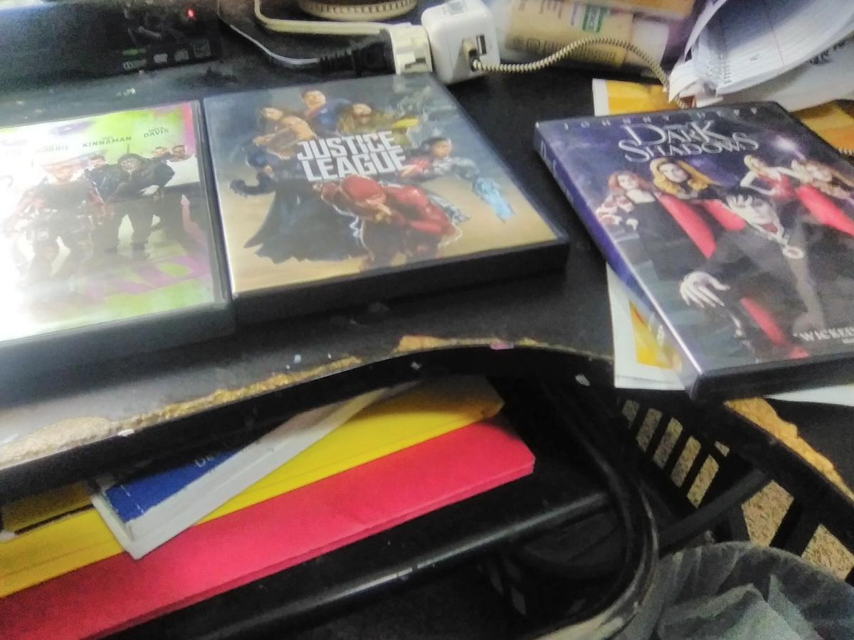 DVD player with bunch of movies image 1