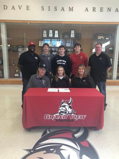 Chloe Gregory signs