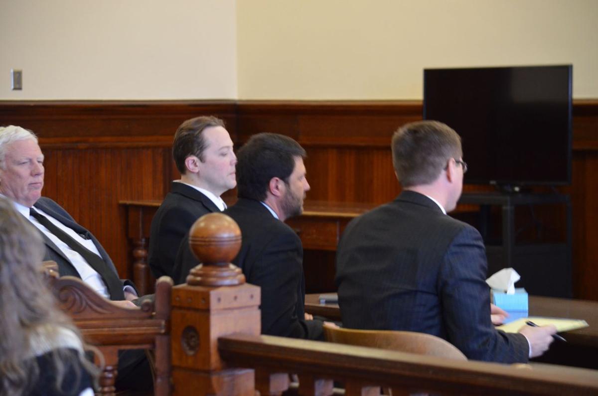 Davis listens to Judge O'Grady's verdict