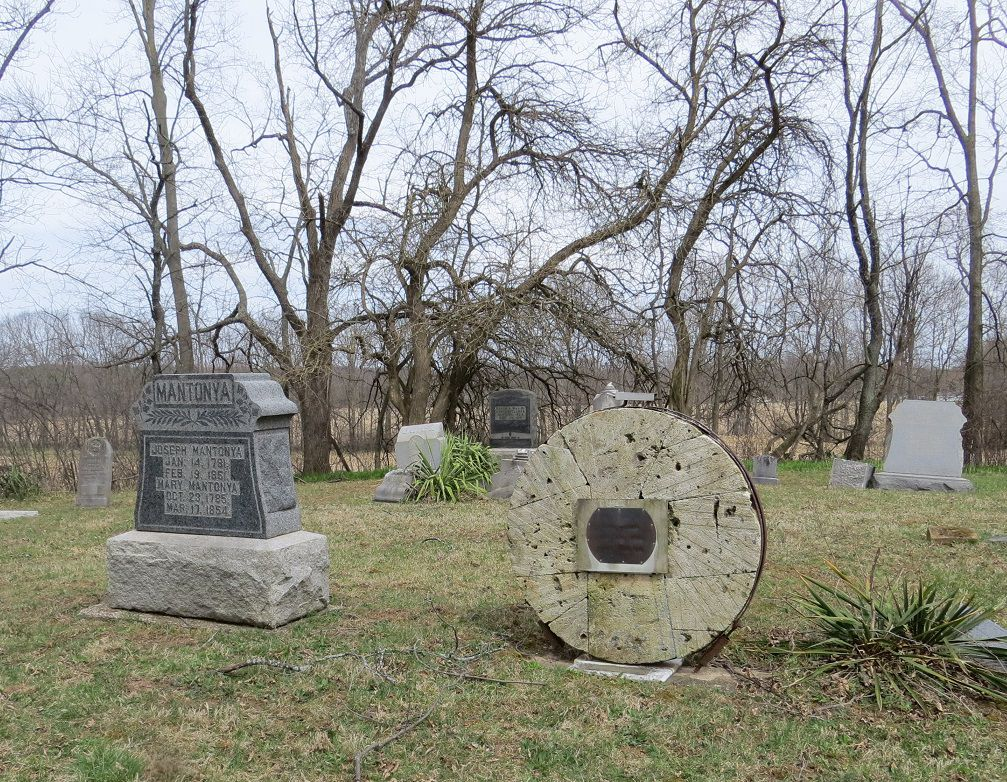 Mantonya gravestone and millwheel.jpg