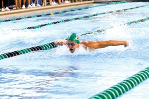 <p>Courtesy of University of Hawaii athletics</p><p>University of Hawaii freshman Talon Lindquist swims during a meet earlier this season in Hawaii. </p>