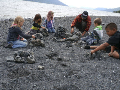 Old Harbor campers survey the beach during a marine science camp.