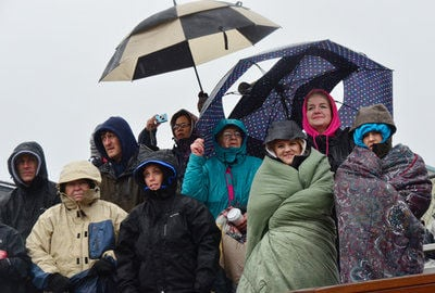 Crowd undeterred by downpour at grand opening for new field