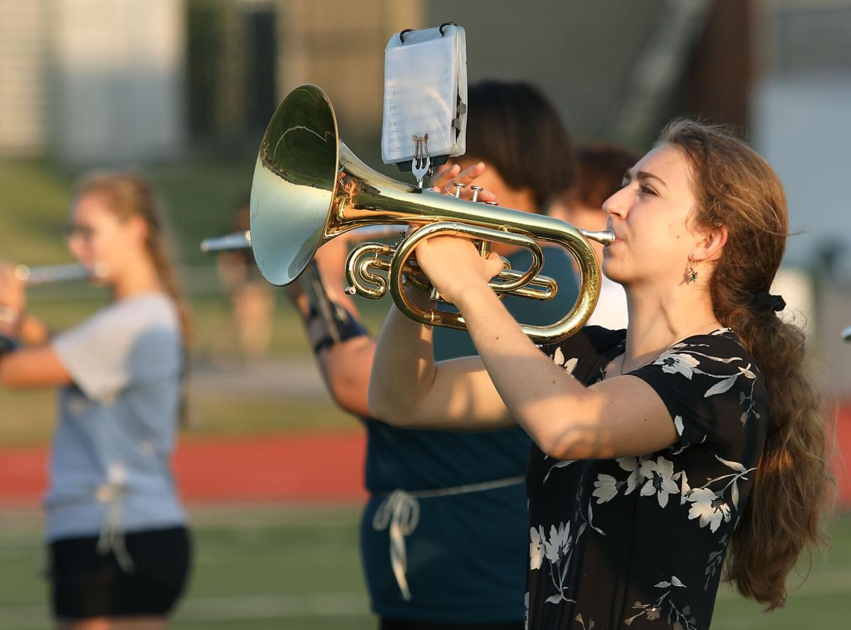 Sophomore Charlotte Stuckhoff reads music while playing her euphonium