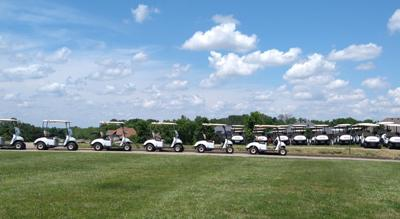 Golf carts lined up at Eagle Knoll Golf Course