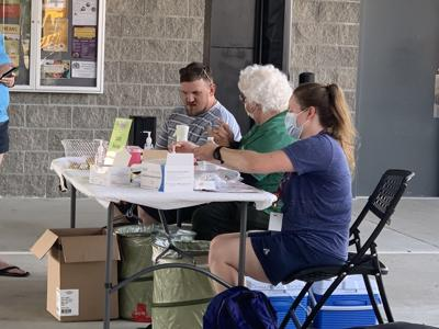 Columbia/Boone County Public Health & Human Services gives out vaccines during food truck roundup