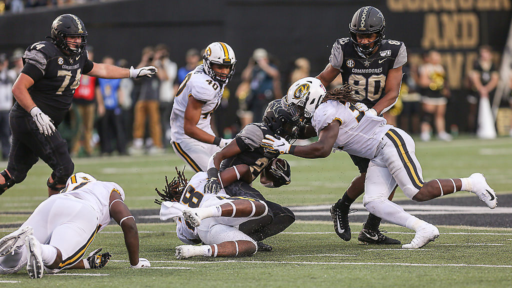 Vanderbilt freshman running back Keyon Brooks is tackled by Missouri linebackers Jatorian Hansford and Nick Bolton