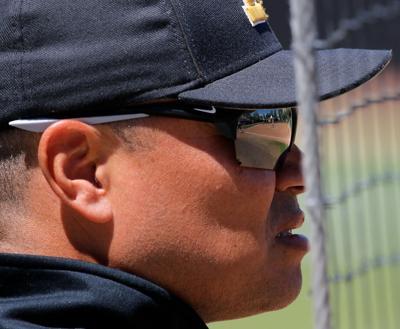 Missouri assistant coach Chris Malveaux watches a Missouri hitter at bat