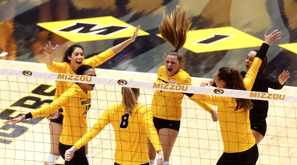 Members of the Missouri volleyball team go in for a group hug
